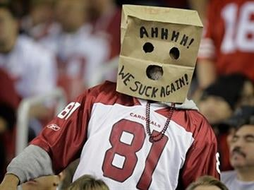 An Arizona Cardinals fan shows his opinion of the team during the third quarter of the Cardinals' NFL football game against the San Francisco 49ers on Monday, Nov. 29, 2010, in Glendale, Ariz. (AP Photo/Paul Connors) By Paul Connors