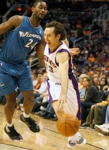 Phoenix Suns guard Steve Nash (13) slips past the defense of Washington Wizards Hilton Armstrong (24) as he drives the baseline during the second quarter of an NBA basketball game, Sunday, Dec. 5, 2010, in Phoenix. (AP Photo/Ralph Freso) By Ralph Freso