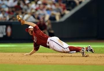 Arizona Diamondbacks third baseman Mark Reynolds makes the diving catch against the Los Angeles Dodgers in the eighth inning during a baseball game on Sunday, July 4, 2010, in Phoenix. (AP Photo/Rick Scuteri) By Rick Scuteri