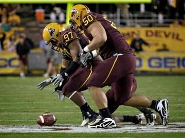 Arizona State defensive end Junior Onyeali (97) and Lawrence Guy (50) scramble for a fumble during the second half of an NCAA football game against Stanford Saturday, Nov. 13, 2010, in Tempe, Ariz. (AP Photo/Matt York) By Matt York