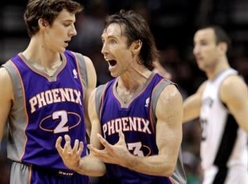 Phoenix Suns' Steve Nash, center, reacts to a call during the first quarter of an NBA basketball game against the San Antonio Spurs, Monday, Dec. 20, 2010 in San Antonio. (AP Photo/Eric Gay) By Eric Gay