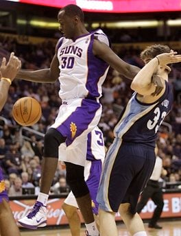 Phoenix Suns' Earl Barron (30) and Memphis Grizzlies center Marc Gasol, right, of Spain, look for a rebound during the first quarter of an NBA basketball game Wednesday, Dec. 8, 2010, in Phoenix. (AP Photo/Matt York) By Matt York