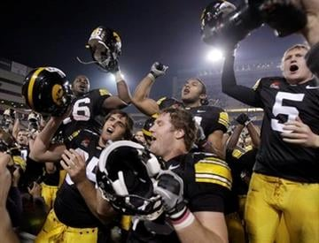 Iowa players celebrate their win over Missouri following the Insight Bowl NCAA college football game Tuesday, Dec. 28, 2010, in Tempe, Ariz. Iowa won 27-24. (AP Photo/Paul Connors) By Paul Connors