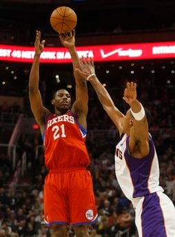 Philadelphia 76ers forward Thaddeus Young, left, shoots over Phoenix Suns center Channing Frye during the first quarter of an NBA basketball game Wednesday, Dec. 29, 2010, in Phoenix. (AP Photo/Rick Scuteri) By Rick Scuteri