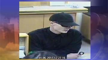 Surveillance photo from robbery at Washington Federal Savings By Jennifer Thomas