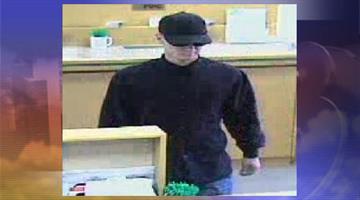 Surveillance photo from robbery at Washington Federal Savings By Jennifer Thomas