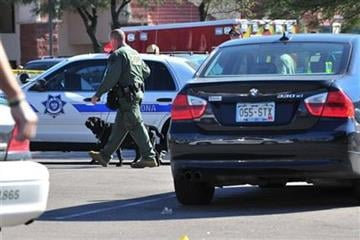 Police search cars at the scene of a shooting involving Rep. Gabrielle Giffords, D-Ariz., Saturday, Jan. 8, 2011, at a Safeway grocery store in Tucson, Ariz.  (AP Photo/Chris Morrison) By Chris Morrison