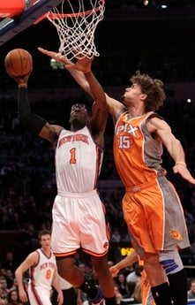 New York Knicks' Amare Stoudemire (1) drives past Phoenix Suns' Robin Lopez (15) during the first half of an NBA basketball game Monday, Jan. 17, 2011, in New York.  (AP Photo/Frank Franklin II) By Frank Franklin II