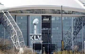 The Super Bowl XLV logo is seen on the east side of Cowboys Stadium, Friday, Jan. 21, 2011, in Arlington, Texas. The stadium will play host the the NFL's football championship game, Sunday,  Feb. 6. (AP Photo/Tony Gutierrez) By Tony Gutierrez