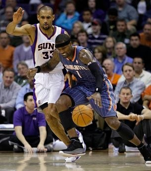 Charlotte Bobcats' Stephen Jackson (1) drives past Phoenix Suns' Grant Hill during the final quarter of an NBA basketball game Wednesday, Jan. 26, 2011, in Phoenix. The Bobcats won 114-107. (AP Photo/Matt York) By Matt York