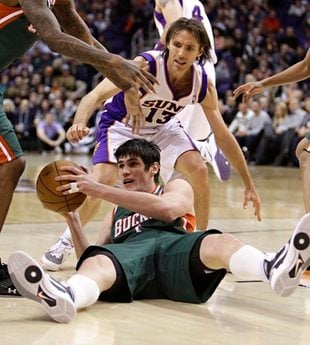 Milwaukee Bucks' Ersan Ilyasova, of Turkey, tries pass as Phoenix Suns' Steve Nash (13) defends during the fourth quarter of an NBA basketball game Wednesday, Feb. 2, 2011, in Phoenix. The Suns won 92-77. (AP Photo/Matt York) By Matt York