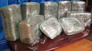 Authorities found marijuana and weapons inside a Phoenix home. By Jennifer Thomas
