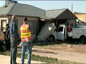 A Qwest truck slammed into a house near 27th Avenue and Bethany Home Road. By Jennifer Thomas