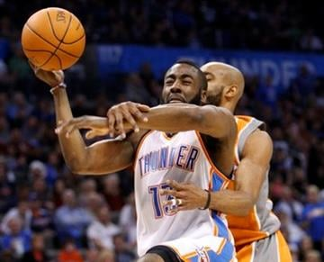 Oklahoma City Thunder guard James Harden, left, is fouled by Phoenix Suns guard Vince Carter during the fourth quarter of an NBA basketball game in Oklahoma City, Sunday, March 6, 2011. Oklahoma City won 122-118. (AP Photo/Sue Ogrocki) By Sue Ogrocki