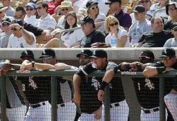 Chicago White Sox players watch their teammates play the Kansas City Royals during the second inning of a spring training baseball game Sunday, March 6, 2011, in Glendale, Ariz. (AP Photo/Nam Y. Huh) By Nam Y. Huh