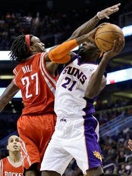 Phoenix Suns forward Hakim Warrick (21) is fouled by Houston Rockets forward Jordan Hill (27) during the third quarter of an NBA basketball game Tuesday, March 8, 2011, in Phoenix. (AP Photo/Matt York) By Matt York