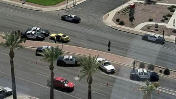 A Fox 11 News twitter follower shot this photo from an office building across the street from the Williams Center, of Tucson Police capturing two bank robbery suspects late Tuesday morning. By Bryce Potter