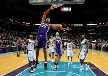Phoenix Suns small forward Grant Hill (33) slam dunks in the second half of an NBA basketball game against the New Orleans Hornets in New Orleans, Wednesday, March 16, 2011. The Hornets won 100-95. (AP Photo) By Catherine Holland