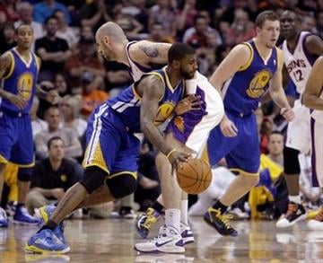 Golden State Warriors forward Dorell Wright, left, collides with Phoenix Suns center Marcin Gortat, right, of Poland, in the second quarter of an NBA basketball game Friday, March 18, 2011, in Phoenix. (AP Photo/Paul Connors) By Paul Connors