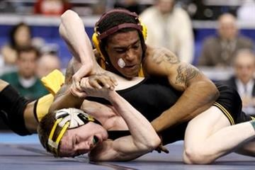 Arizona State's Anthony Robles, top, battles against Iowa's Matt McDonough during their 125-pound finals match, Saturday, March 19, 2011, at the NCAA Division I Wrestling Championships in Philadelphia. (AP Photo/Matt Slocum) By Matt Slocum