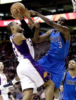 Phoenix Suns' Grant Hill is fouled by Dallas Mavericks' Rodrigue Beaubois, of Guadeloupe, during the third quarter of an NBA basketball game Sunday, March 27, 2011, in Phoenix. (AP Photo/Matt York) By Matt York