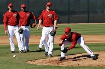Arizona Diamondbacks pitcher Jarrod Parker, right, goes through drills as fellow pitchers look on at the team's spring training baseball facility in Scottsdale, Ariz. Monday, Feb. 14, 2011. (AP Photo/Marcio Jose Sanchez) By Marcio Jose Sanchez