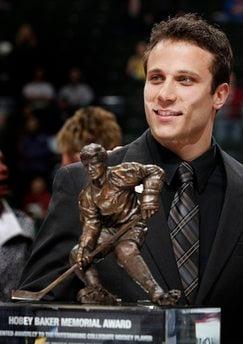 Miami University senior forward Andy Miele smiles after winning the Hobey Baker Memorial Award for the top NCAA hockey player in a ceremony in St. Paul, Minn. Friday April 8, 2011.(AP Photo/Andy King) By Andy King