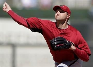 Arizona Diamondbacks pitcher Aaron Heilman pitches to the Kansas City Royals in the first inning of a spring training baseball game in Surprise, Ariz., Monday, March 7, 2011. (AP Photo/Lenny Ignelzi) By Lenny Ignelzi