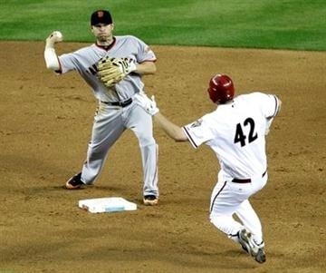 San Francisco Giants' Freddy Sanchez, left, forces out Arizona Diamondbacks' Daniel Hudson during a double play during the third inning of an MLB baseball game Friday, April 15, 2011, in Phoenix. (AP Photo/Matt York) By Matt York