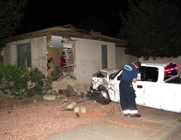 A truck crashed into a Mesa home, leaving a large hole. By Jennifer Thomas