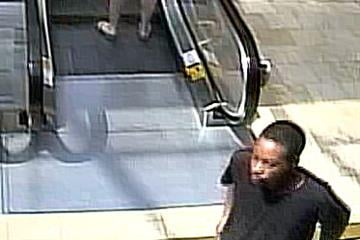 The robbery suspect was seen in Scottsdale Fashion Square Mall with this man. By Jennifer Thomas