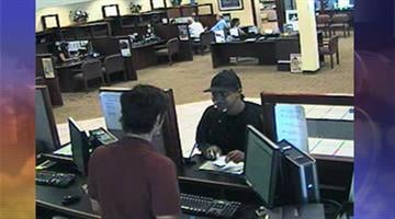 Surveillance photo of robbery at First Credit Union in Tempe By Jennifer Thomas