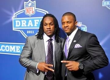 Kentucky wide receiver Randall Cobb, right, poses for photographs with Ryan Williams, left, before the first round of the NFL football draft at Radio City Music Hall on Thursday, April 28, 2011, in New York. (AP Photo/Stephen Chernin) By Stephen Chernin