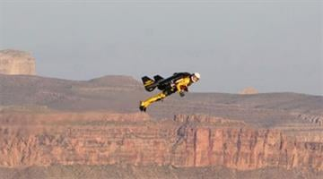 """Yves """"Jetman"""" Rossy soars over the Grand Canyon. By Jennifer Thomas"""