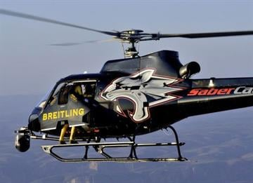 """Yves """"Jetman"""" Rossy launched from a helicopter at 8,000 feet. By Jennifer Thomas"""