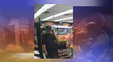 Surveillance photo of one of the suspects By Jennifer Thomas