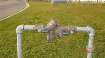 Backflow valves are commonplace at commercial buildings, parks and schools, and although styles may vary they look something like this. By Jennifer Thomas