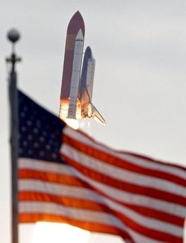 Space shuttle Endeavour flies past the US Flag after launch at Cape Canaveral, Fla., on Monday, May 16, 2011.  (AP Photo/John Raoux) By John Raoux