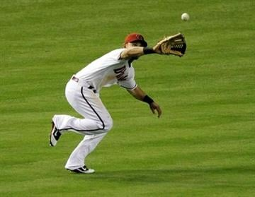 Arizona Diamondbacks' Gerardo Parra catches a fly out by San Diego Padres Ryan Ludwick during the sixth inning of a baseball game Tuesday, May 17, 2011, in Phoenix. (AP Photo/Matt York) By Matt York