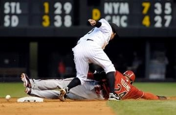 Arizona Diamondbacks' Chris Young (24) steals second as Colorado Rockies shortstop Alfredo Amezaga, top, mishandles the throw during the sixth inning of an MLB baseball game on Wednesday, May 25, 2011, in Denver. (AP Photo/Jack Dempsey) By Jack Dempsey