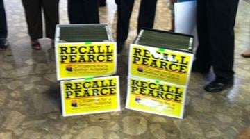 Crates containing more than 17,000 signatures of Mesa voters wanting to recall Senate President Russell Pearce sit in the lobby of the state Capitol Tuesday afternoon. By Jennifer Thomas
