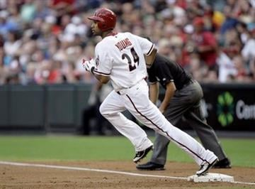 Arizona Diamondbacks' Chris Young watches his solo home run leave the field as he rounds first base against the Washington Nationals in the second inning of an MLB baseball game Friday, June 3, 2011, in Phoenix. (AP Photo/Paul Connors) By Paul Connors