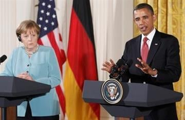 President Barack Obama and German Chancellor Angela Merkel take part in a joint news conference in the East Room at the White House in Washington, Tuesday, June 7, 2011. (AP Photo/Charles Dharapak) By Charles Dharapak