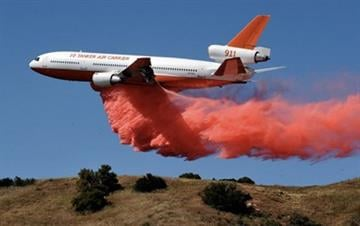Tanker 911 dropped slurry on the Jesusita Fire in Santa Barbara County last year. By Catherine Holland