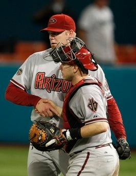 Arizona Diamondbacks relief pitcher J.J. Putz, left, shakes hands with catcher Miguel Montero, right, after the Diamondbacks defeated the Florida Marlins 12-9 during a baseball game in Miami, Monday, June 13, 2011. (AP Photo/Lynne Sladky) By Lynne Sladky