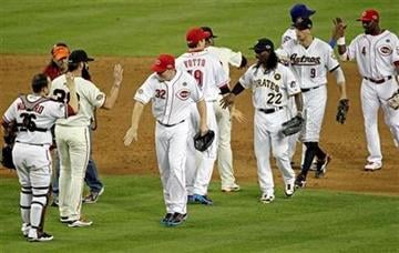 National League players celebrate after winning the MLB All-Star baseball game by defeating the American League 5-1 Tuesday, July 12, 2011, in Phoenix. (AP Photo/Matt York) By Matt York