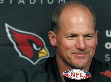 Arizona Cardinals head coach Ken Whisenhunt smiles as he speaks to the media during a news conference at the team's football training facility, Tuesday, July 26, 2011, in Tempe, Ariz., the day after the NFL lockout ended. By Catherine Holland