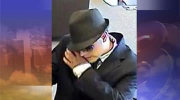 Suspect at Bank of America on West Happy Valley Road in Phoenix on Aug. 16 By Jennifer Thomas
