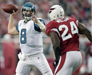 Seattle Seahawks quarterback Matt Hasselbeck (8) throws as Arizona Cardinals safety Adrian Wilson (24) defends during the third quarter of an NFL football game Sunday, Nov. 14, 2010, in Glendale, Ariz. (AP Photo/Ralph Freso) By Ralph Freso