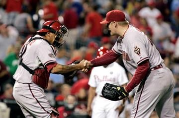 Arizona Diamondbacks catcher Henry Blanco, left, and closing pitcher J.J. Putz celebrate a 3-2 win over the Philadelphia Phillies in a baseball game, Tuesday, Aug. 16, 2011, in Philadelphia. (AP Photo/Tom Mihalek) By Tom Mihalek
